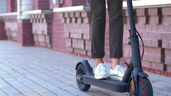 Nodern Woman On Electric Scooter