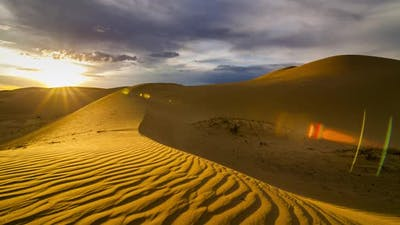 Sunset Over the Sand Dunes in the Desert
