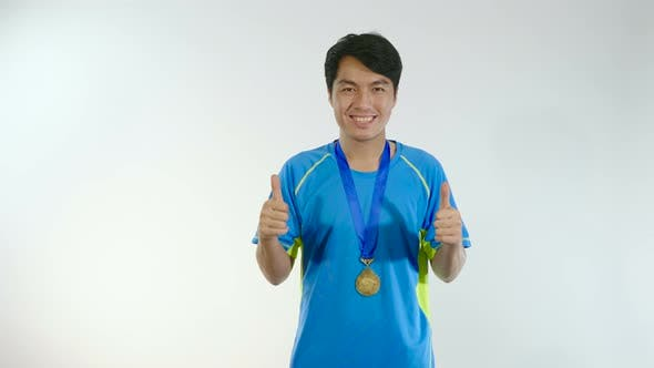 Man Thumbs Up With Gold Medal