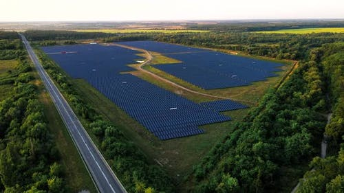 Ecology Solar Power Station Panels in the Fields Green Energy at Sunset Landscape Electrical