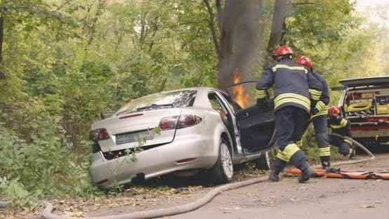 Thumbnail for Firemen Rescuing Couple From Burning Car