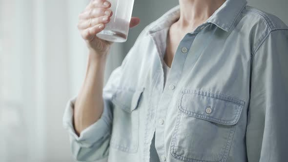 Thumbnail for Healthy Woman Drinking Sparkling Water at Home, Freshness and Dieting, Closeup