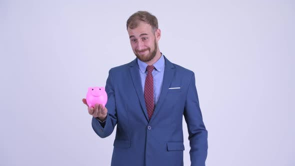 Happy Bearded Businessman Holding Piggy Bank and Giving Thumbs Up