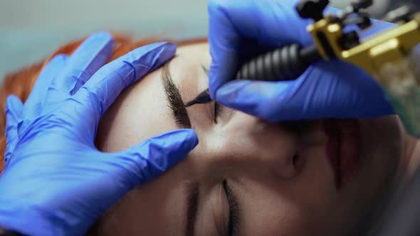 Thumbnail for Beauty Master is Performing Tattooing Eyebrow