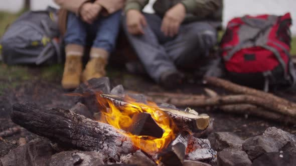 Cover Image for Happy Senior Couple Embracing and Talking while Watching Campfire