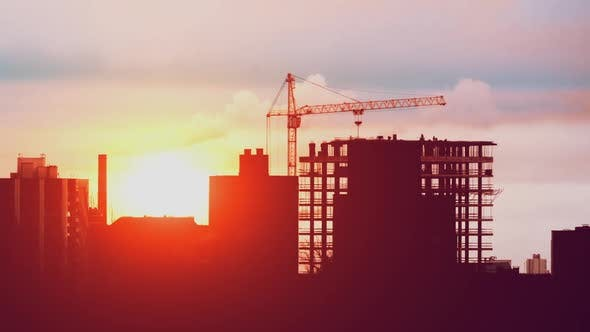 Thumbnail for Crane Working on Construction Site Residential Building in City, Constructors Working Golden Hour