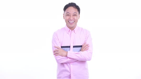 Thumbnail for Happy Japanese Businessman Smiling with Arms Crossed