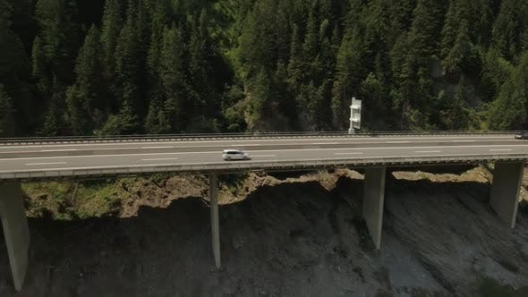 Thumbnail for Scenic View of a Highway Beside a Mountain Range with a View of the Forest