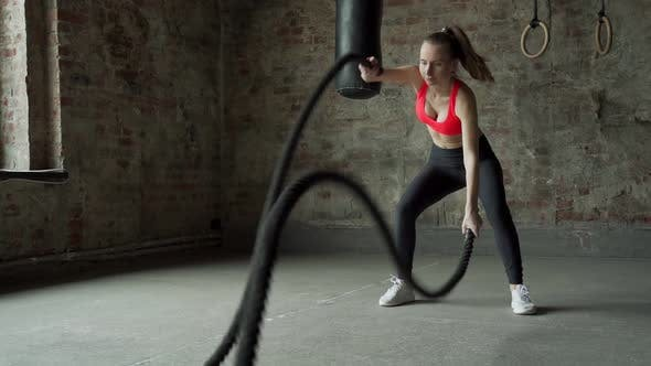 Young Fit Sportswoman Working Out in Fitness Training Gym
