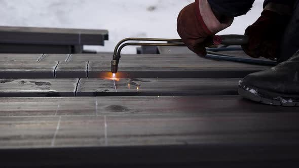 Thumbnail for The Builder Cuts the Metal with a Special Burner. Protective Gloves