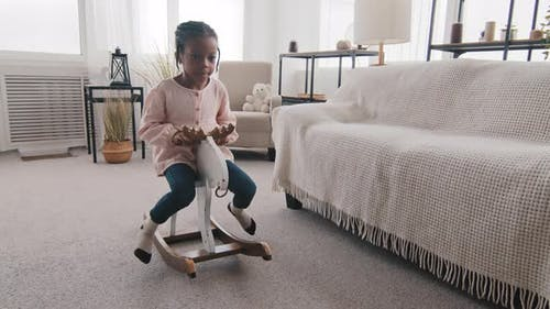 Little Afro American Girl Black Child Small Kid Baby Schoolgirl Daughter Sitting on Wooden Horse