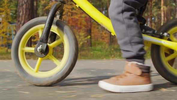 Close Up of Unrecognizable Kid on Balance Bike