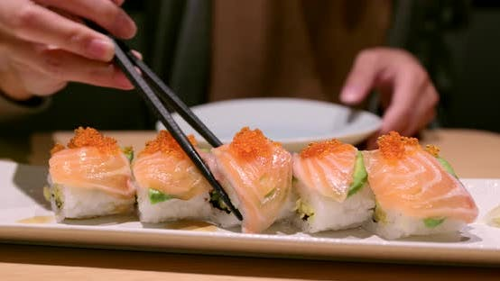 Thumbnail for Woman Enjoy the Japanese Sushi in Restaurant
