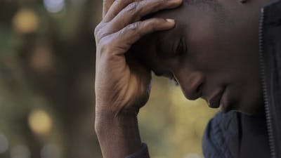 desperate worried young black african man. Worries,troubles