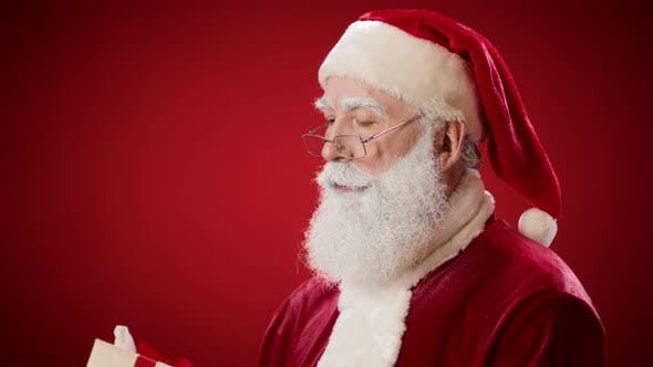 Thumbnail for Santa Claus with Present in His Hands