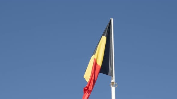 Thumbnail for Flag of Belgium tricolour stripes against blue sky close-up 4K 2160p 30fps UltraHD footage - Famous