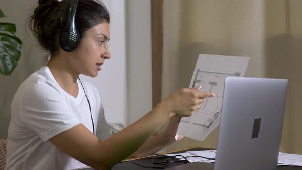 female Indian architect during meeting in an office using laptop computer online