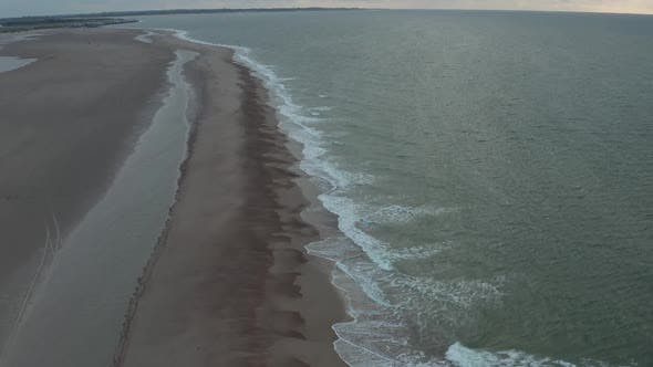 Thumbnail for Beautiful Coastline of Northern Belgium Beach on Cloudy Sunset, Aerial Moving Forward