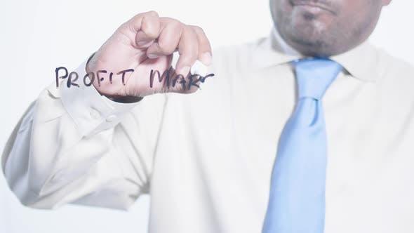 Asian Businessman Writes Profit Margin