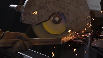 Close Up Shot of an Industrial Electric Saw for the Leveling of Metal.