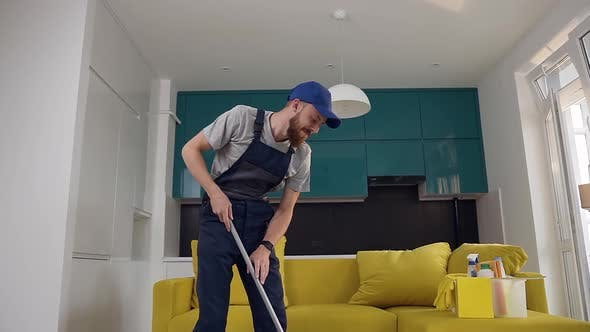Thumbnail for Man with Beard from Cleaning Service Washing the Floor in the Kitchen