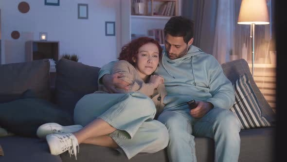 Woman Crying at Movie at Night