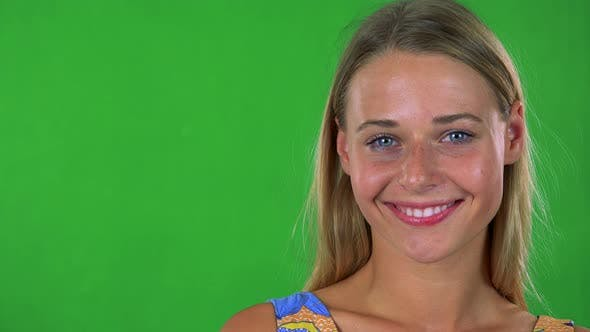 Thumbnail for Young Pretty Blond Woman Smiles To Camera - Green Screen - Studio