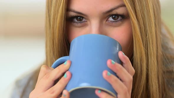 Thumbnail for Mexican woman drinking coffee