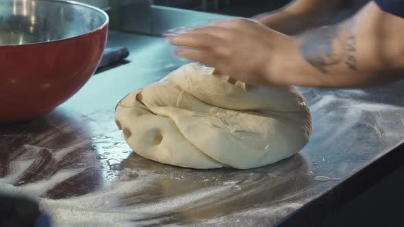 Professional Baker Preparing Dough Working at the Kitchen