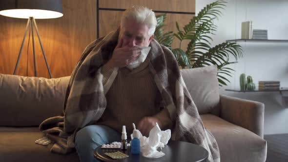 Thumbnail for Coronavirus CoVid-19 with Pandemic Epidemic Warning - Adult Senior Old Man with Fever Symptoms Like