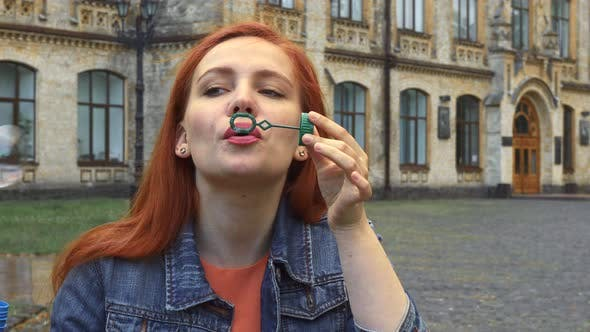 Thumbnail for Girl Blowing Bubbles
