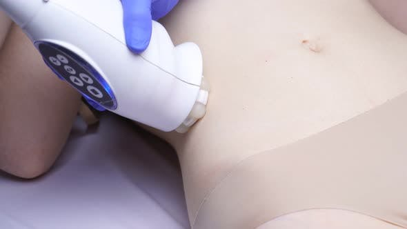 Woman Receives a Hardware Dermotonia Procedure at a Cosmetology Clinic.