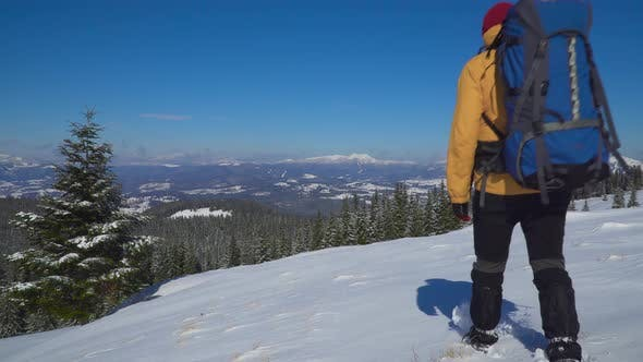 Thumbnail for Man Backpacker Tourist Walking Snow Landscape