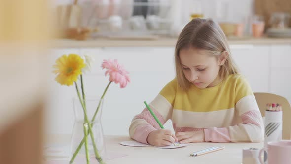 Kid Drawing Using Coloured Pencils