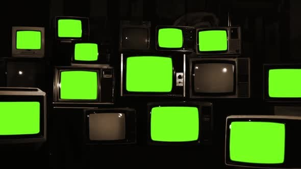 Thumbnail for Stack of Retro TVs turning On Green Screens with Noise. Sepia Tone.