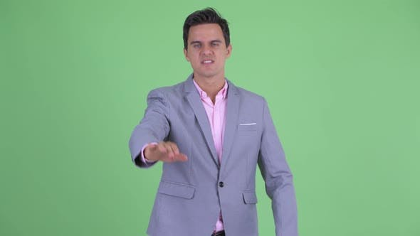Thumbnail for Serious Young Handsome Businessman with Stop Gesture