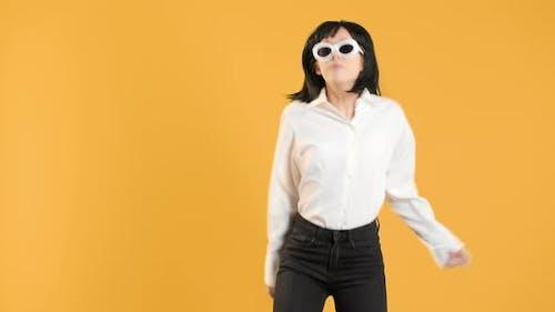 Portrait Closeup of Happy Stylish Female with Bob Hairdo Wearing Fancy Sunglasses Dancing Energetic