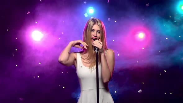 Cover Image for Sexy Woman Singing Into Retro Microphone, Smoke Effect. Slow Motion