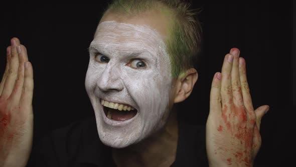 Thumbnail for Clown Halloween Man Portrait. Close-up of an Evil Clowns Face. White Face Makeup