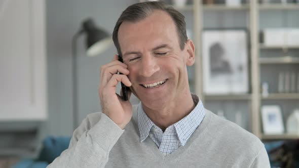 Thumbnail for Portrait of Middle Aged Man Talking on Phone