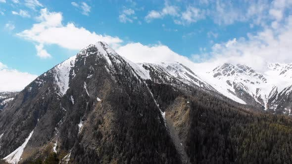 Thumbnail for Aerial View of Snowy Peaks of Swiss Alps and Pine Forest in the Gorge, Switzerland