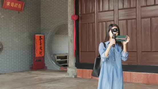 Woman taking footage Ping shan heritage trail