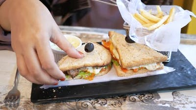 Slice of Beef Sandwich and Chips on Plate on Table