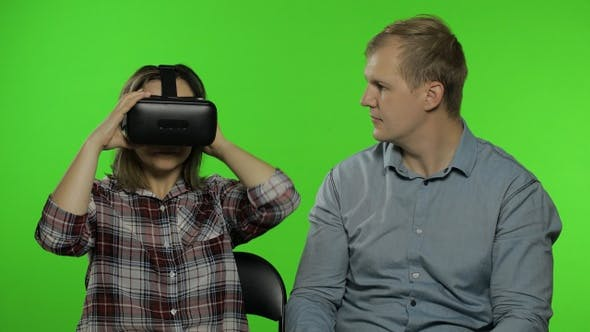 Thumbnail for Man and Woman Using VR Headset Helmet To Play Game. Watching Virtual Reality 3D Video. Chroma Key
