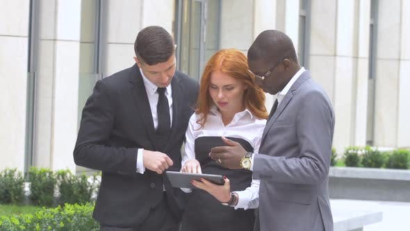 Thumbnail for Multi Ethnic Business Eteam at Company Office Building, Work on the Tablet