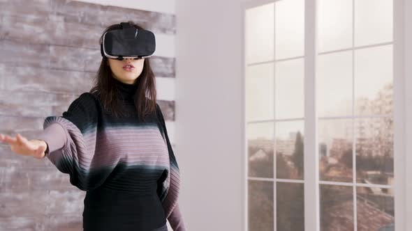 Thumbnail for Beautiful Female Home Designer Using Virtual Reality Goggles