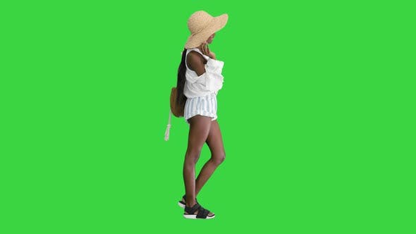 Thumbnail for Smiling Young African American Woman in a Straw Hat Posing on a Green Screen, Chroma Key.