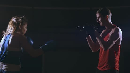 Thumbnail for Fitness Woman Athlete Boxing Punching Focus Mitts Enjoying Intense Exercise Female Fighter Training