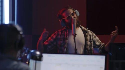 Passionate Vocalist Singing in Studio