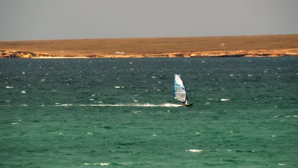 Cover Image for Man On Windsurf Board